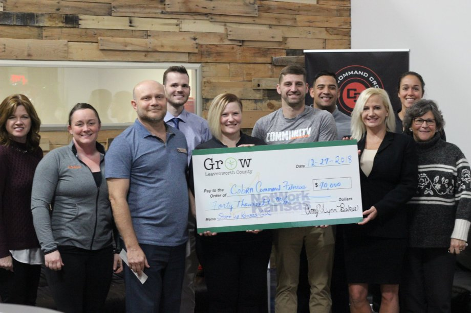 Grow Leavenworth County Presents Network Kansas Start Up Loan Check To Cobra Command Crossfit